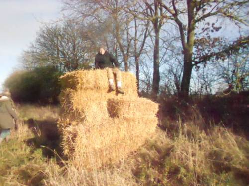 Ethan on the pile of bales