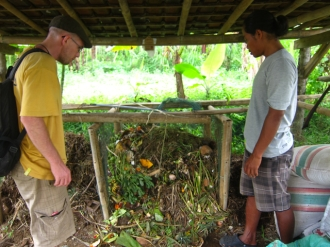 Inspecting compost with Wayan